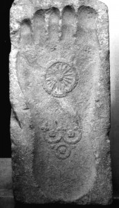 Buddha footprint showing dharmawheel and three treasure symbols